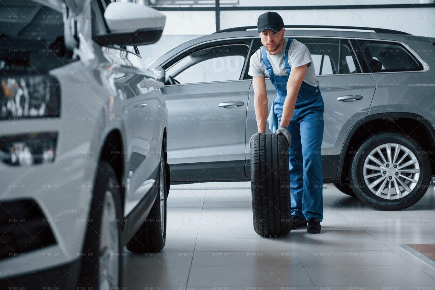 Holding A Tire: Stock Photos