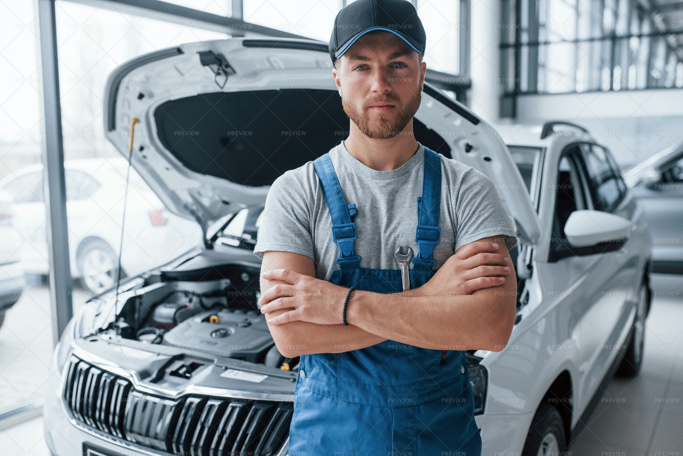 Employee In Blue Colored Uniform: Stock Photos