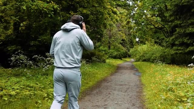 Male Athlete Jogging In Park: Stock Video