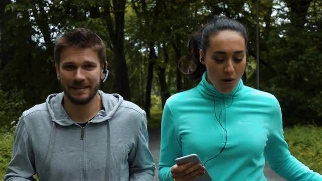 Young Couple Jogging In Park: Stock Video
