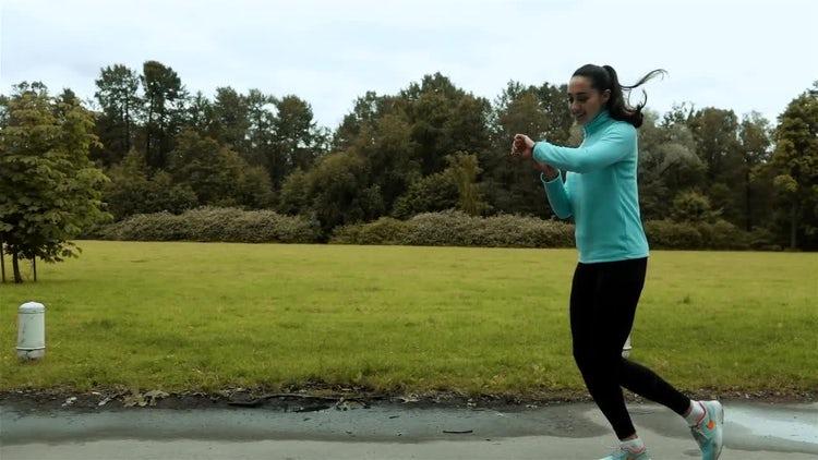 Woman Runner Uses Smart Watch: Stock Video