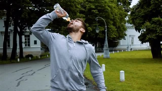 Runner Takes A Drink After Exercise: Stock Video
