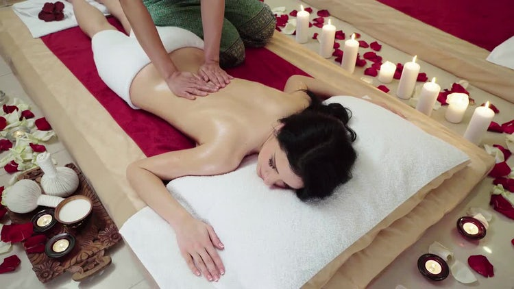 Woman Receiving Lower Back Massage: Stock Video