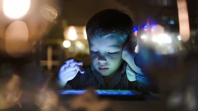 Boy Playing Games On Tablet : Stock Video