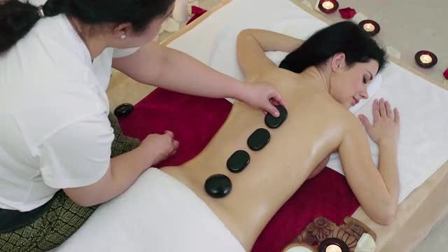 Girl Enjoying Hot Stone Massage: Stock Video