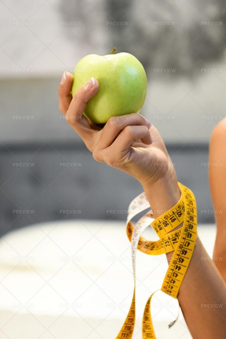 Woman Holding A Green Apple: Stock Photos