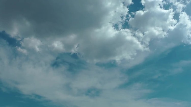 Clouds Over Blue Summer Sky: Stock Video