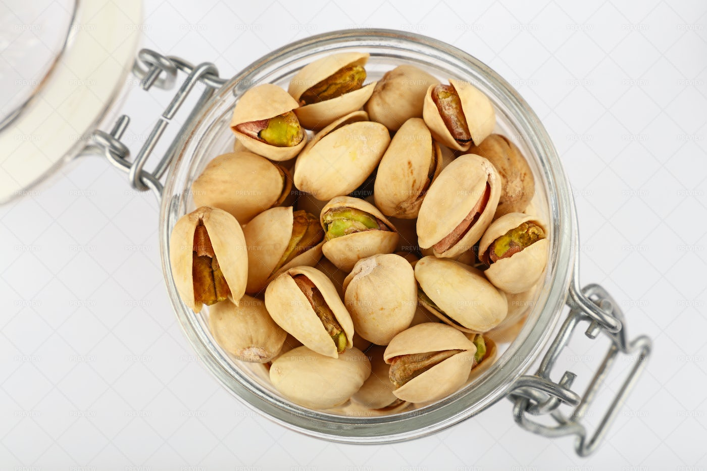 Roasted Pistachio Nuts In Jar: Stock Photos