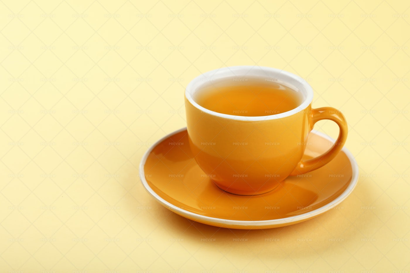 Yellow Cup Of Tea: Stock Photos