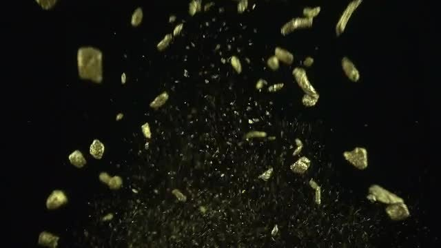 Pieces Of Gold Exploding: Stock Video