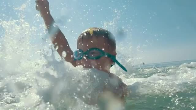 Happy Child Enjoying Splashing: Stock Video
