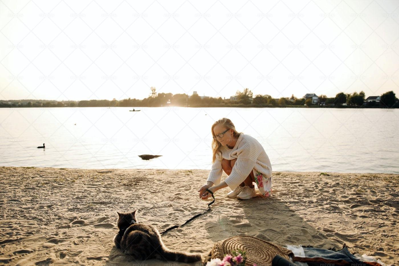 Woman Lying On Beach With Cat: Stock Photos