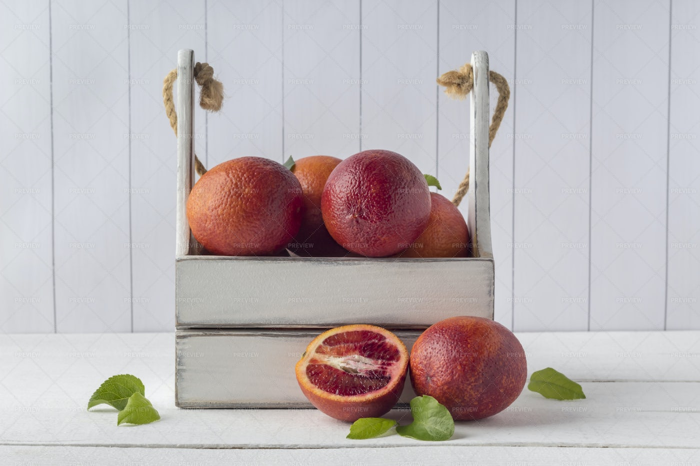 A Crate Of Blood Oranges On White: Stock Photos