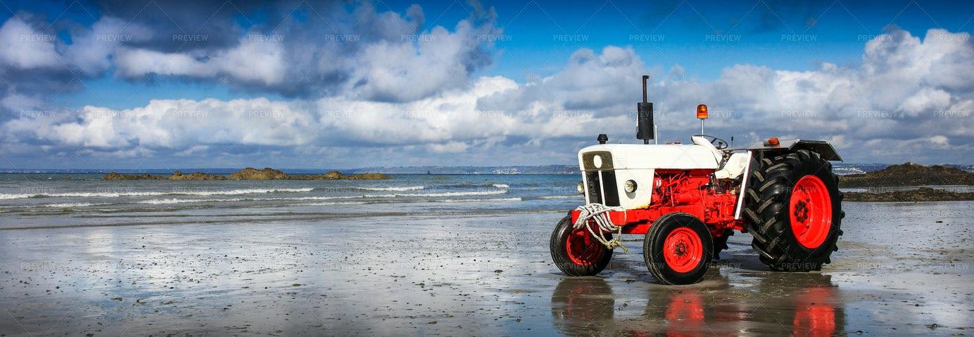 Tractor On The Shoreline: Stock Photos
