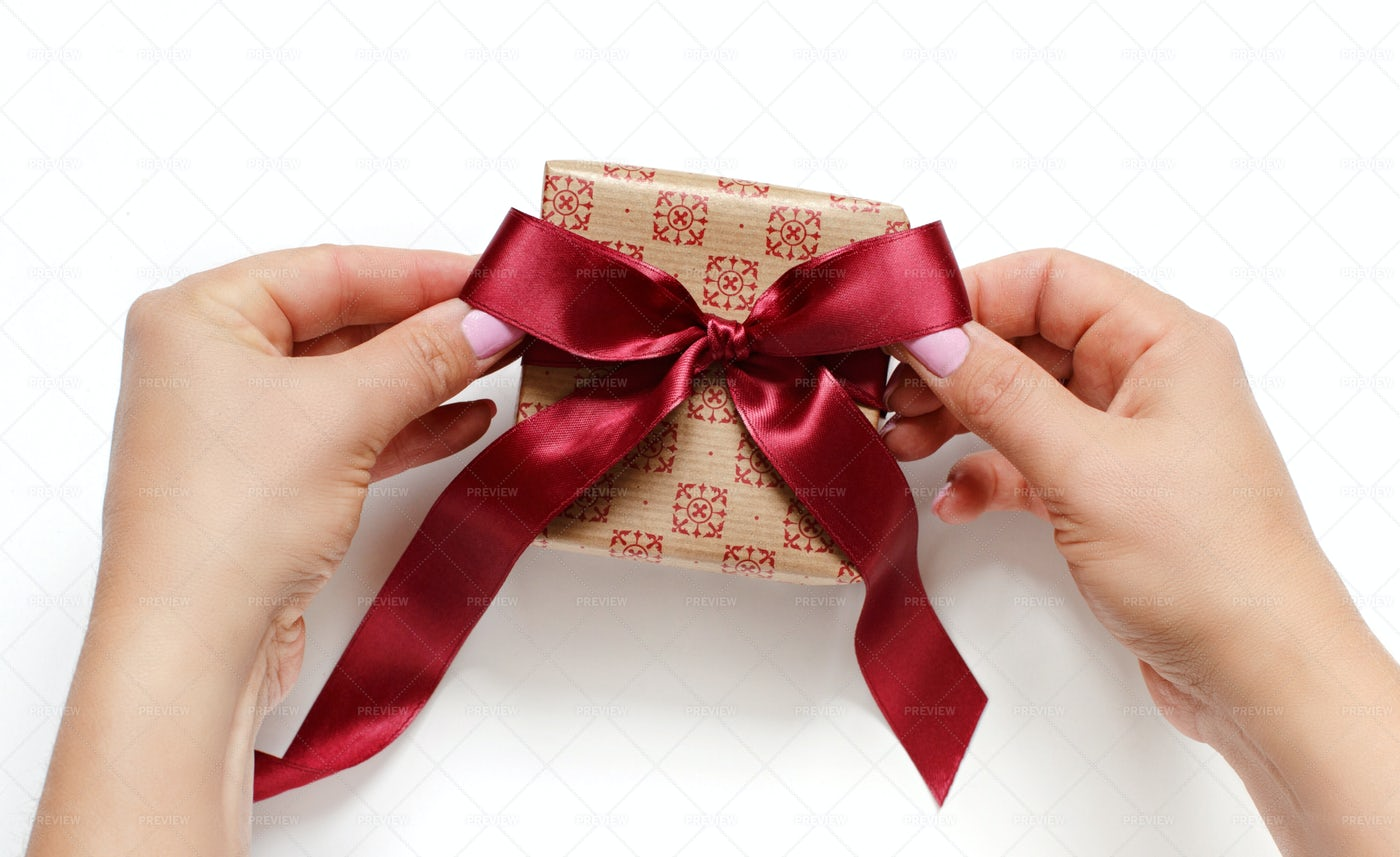 Tying A Ribbon Bow: Stock Photos