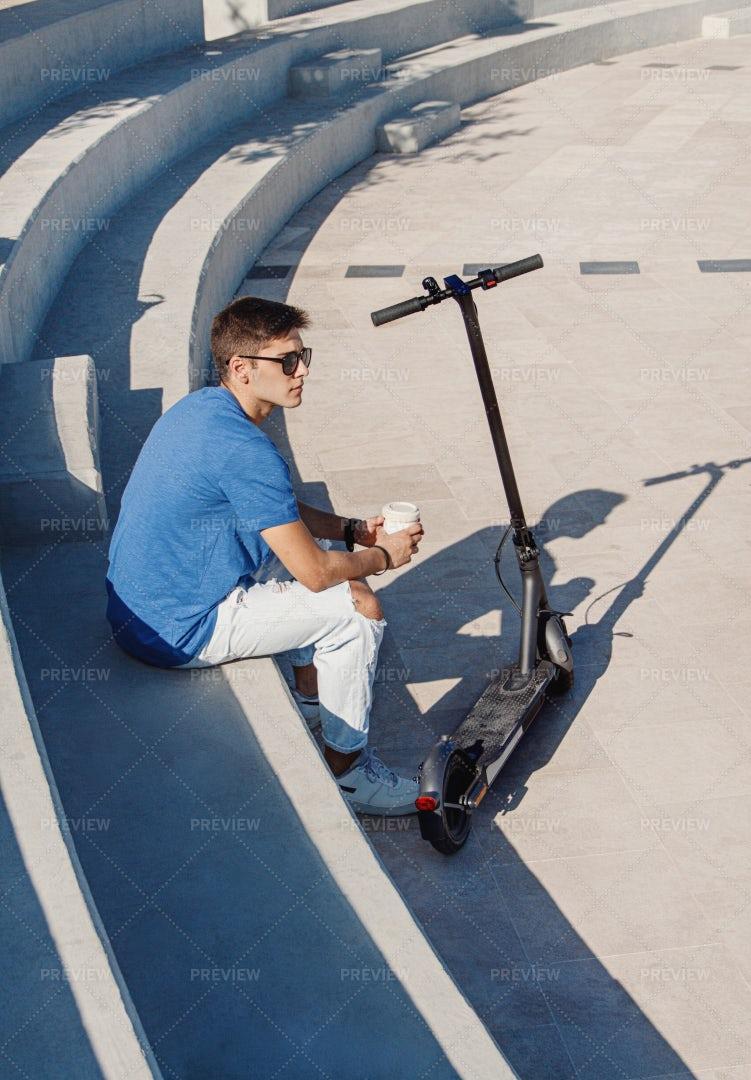 Man Near Electric Scooter: Stock Photos