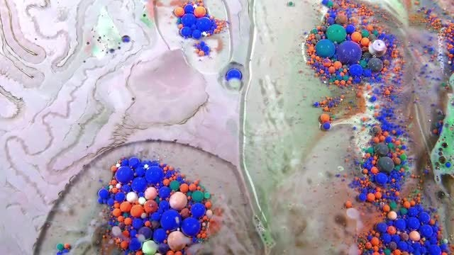 Colored Paint Mixtures With Bubbles: Stock Video