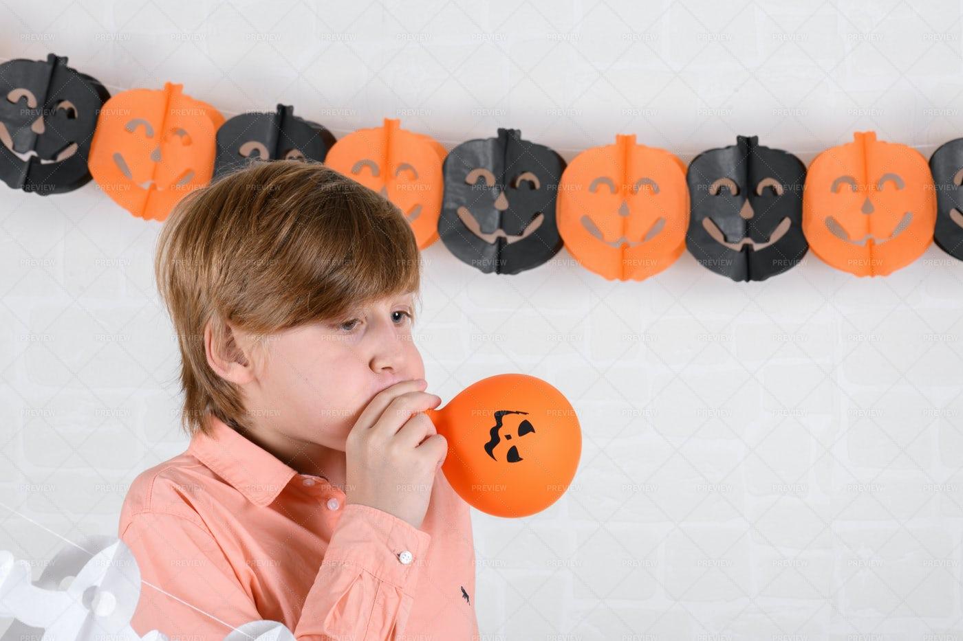 Boy Inflates A Balloon: Stock Photos