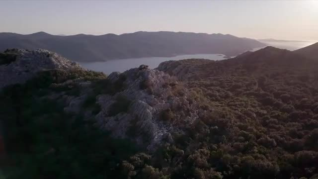Mountain by the Seaside at Sunset: Stock Video