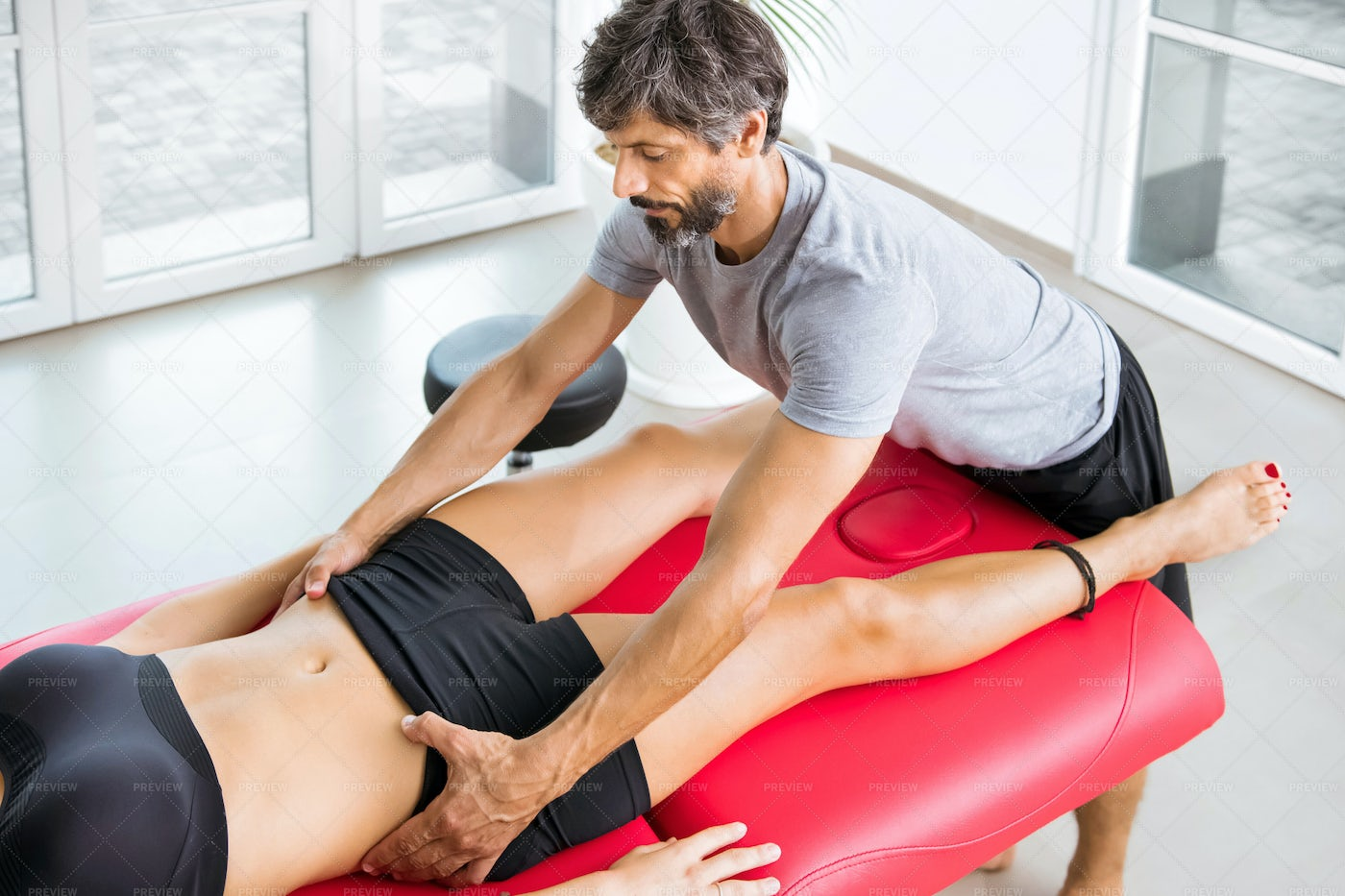 Osteopath Performing A Pelvis Alignment: Stock Photos