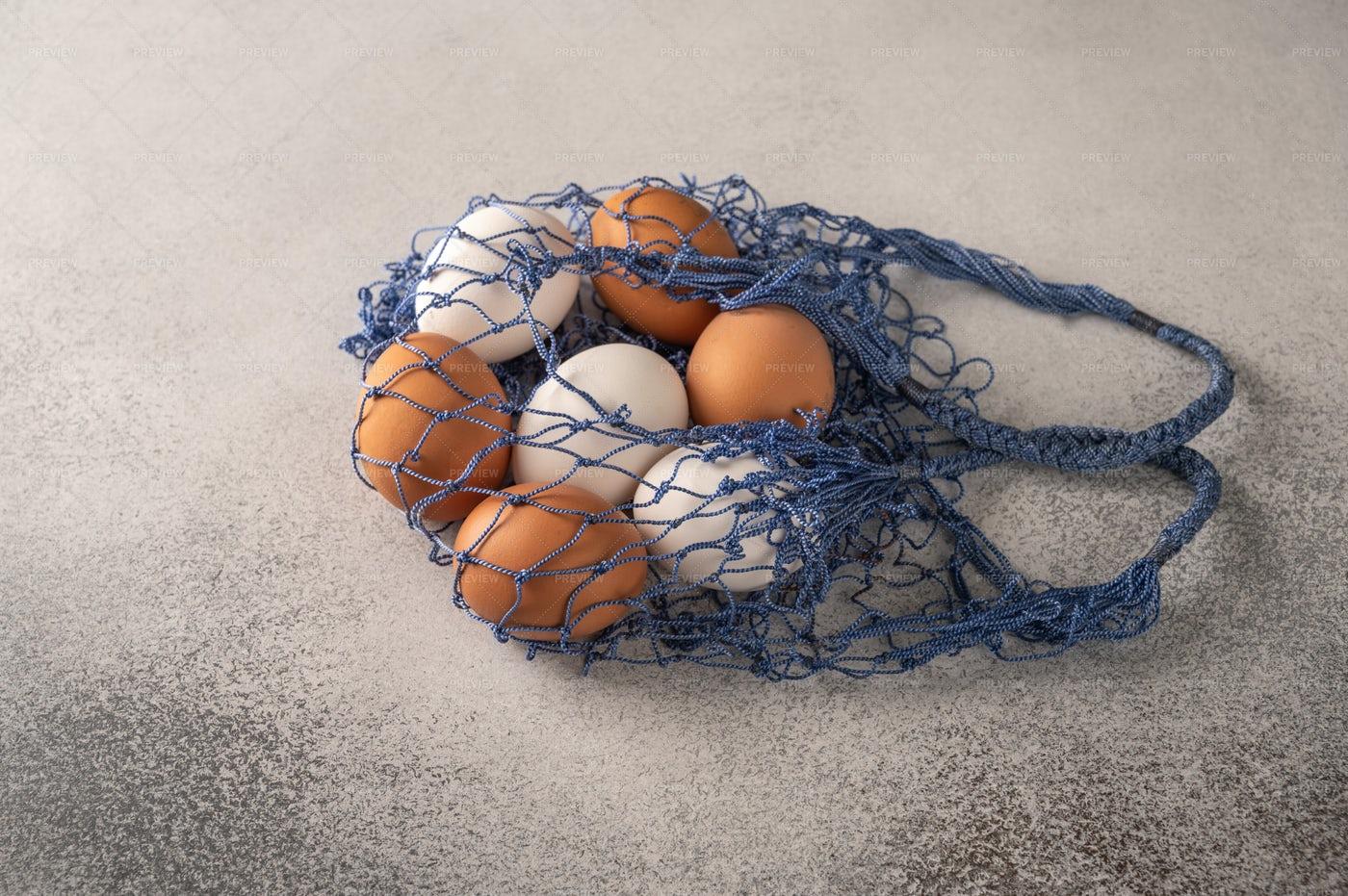 Eggs In String Bag: Stock Photos