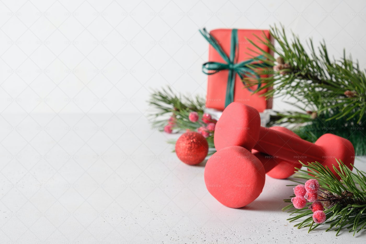 Christmas Holiday With Dumbbells: Stock Photos