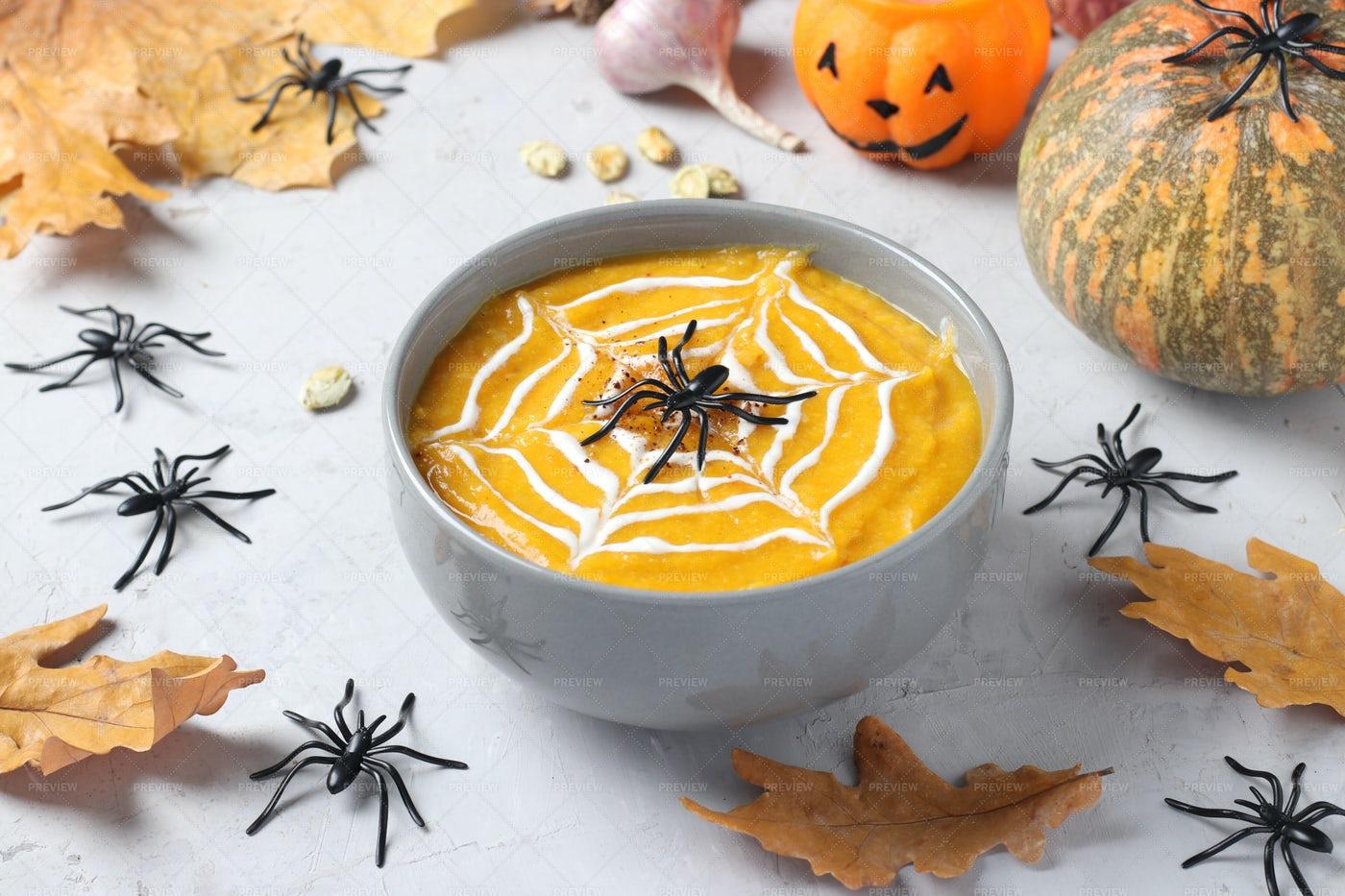 Halloween Pumpkin Soup With Spiders: Stock Photos