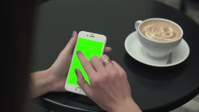 Woman Using Smartphone In Restaurant: Stock Video