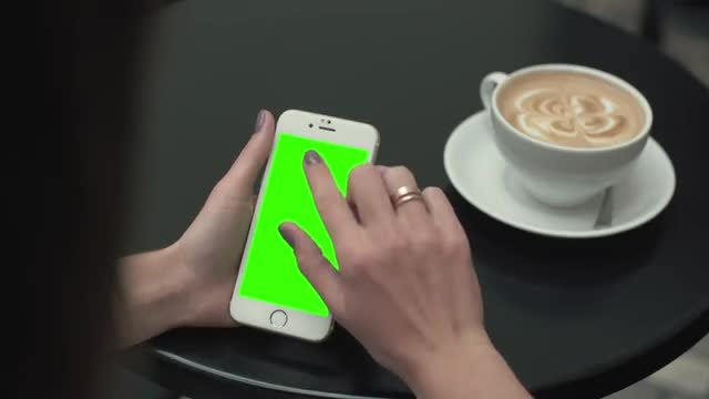 Green Screen Mobile Phone In Cafe : Stock Video