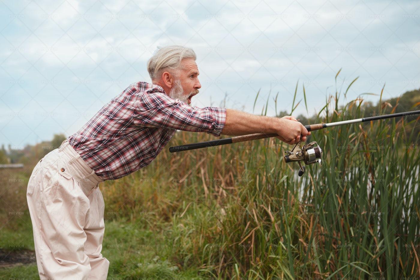Fisherman Pulling Fish: Stock Photos