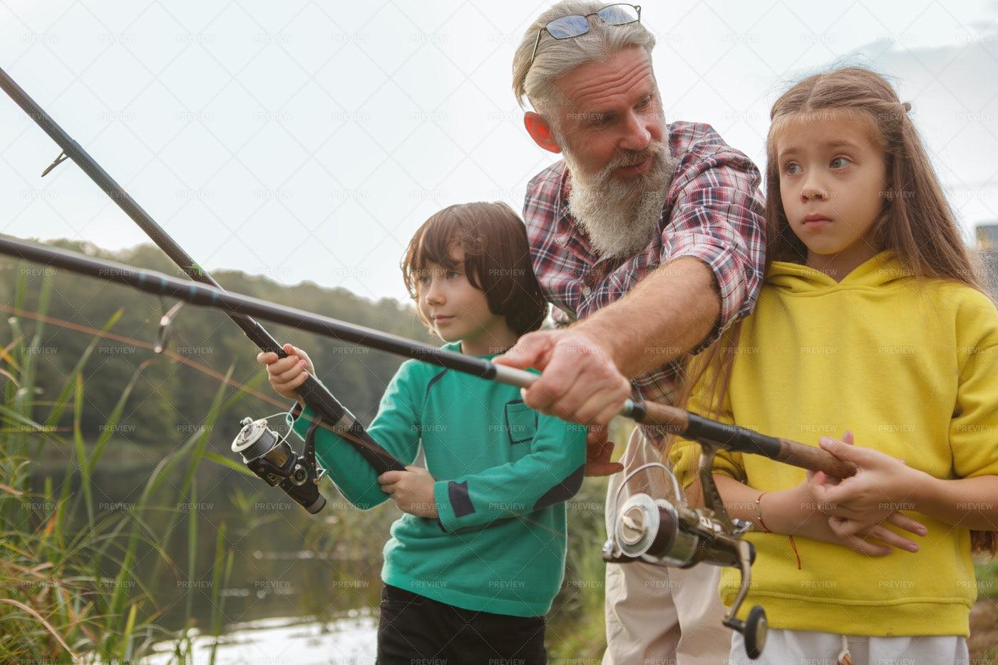 Kids Fishing With Grandpa: Stock Photos