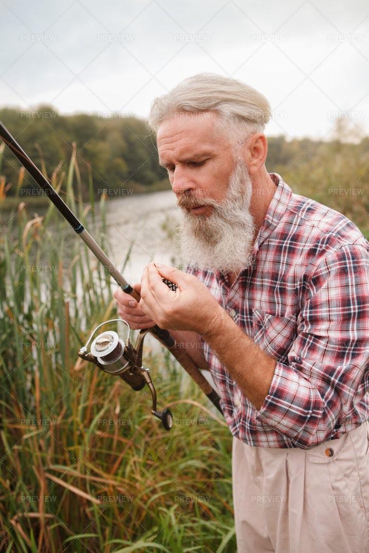 Fisherman Examining His Fish Hooks: Stock Photos