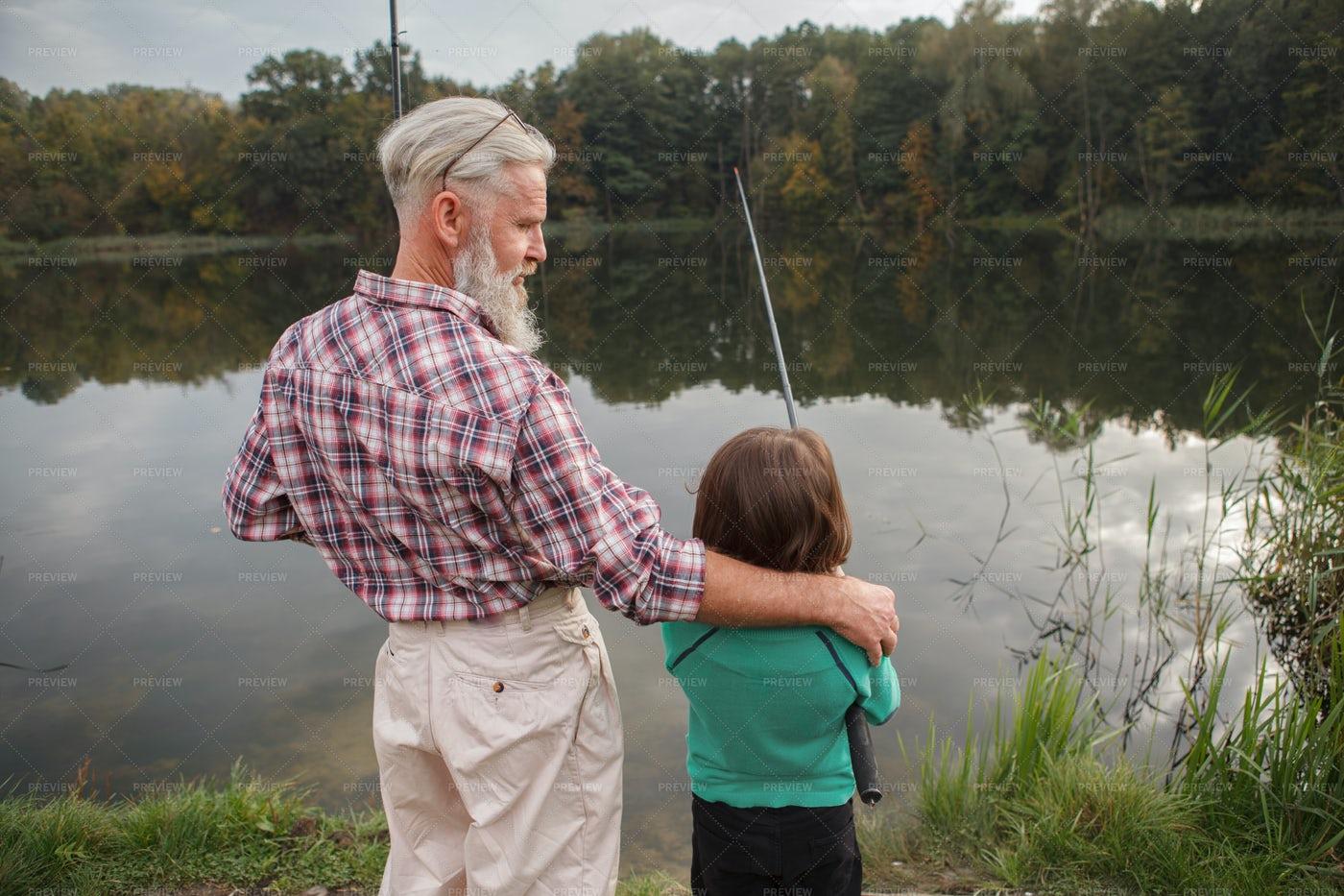 Grandpa Hugging Grandson While Fishing: Stock Photos