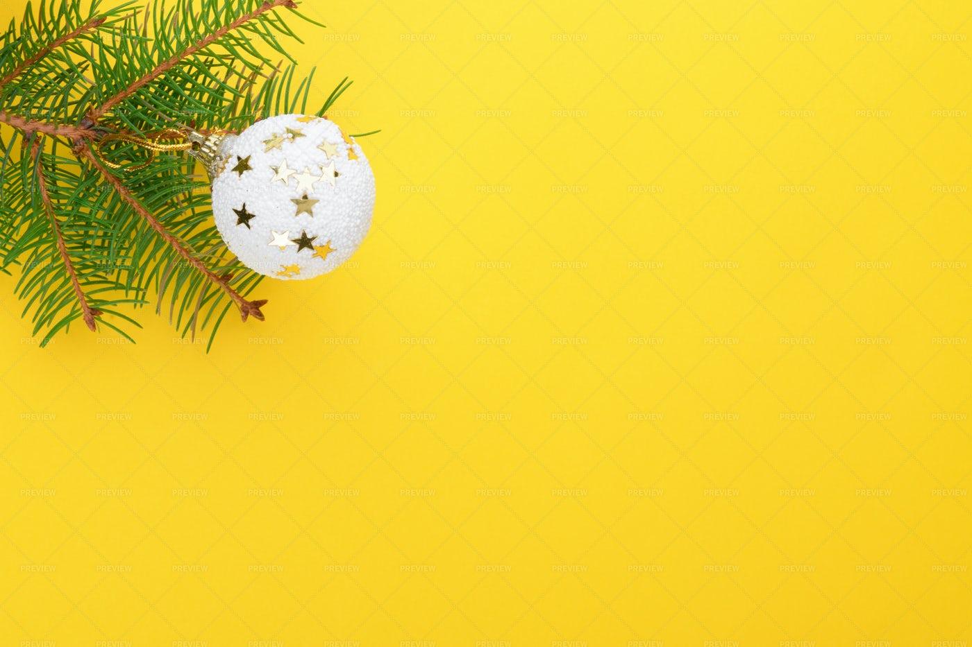 Christmas Ball Over Yellow: Stock Photos