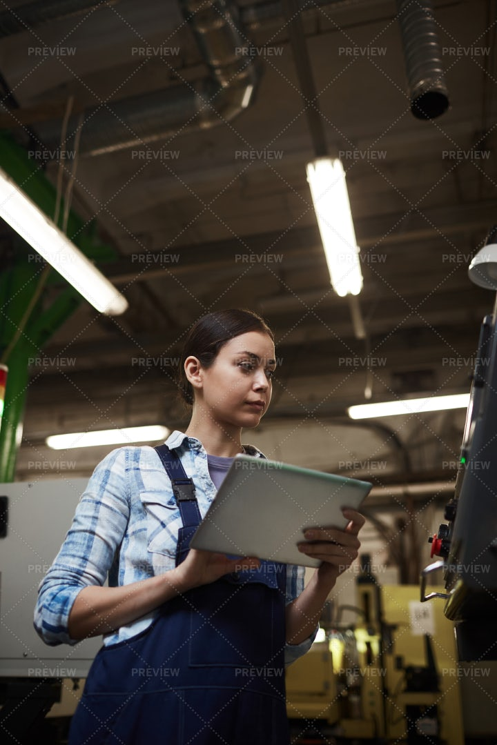 Industrial Woman Checking Machine: Stock Photos