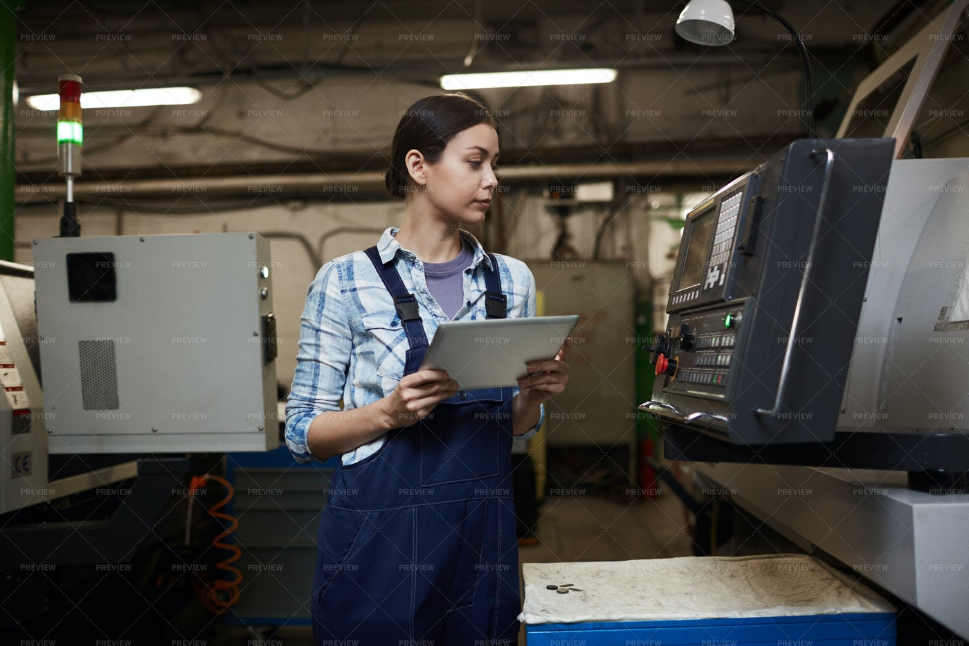 Woman Technician Controlling Machinery: Stock Photos