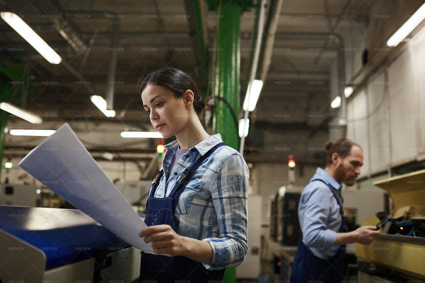 Engineer With Blueprint In The...: Stock Photos