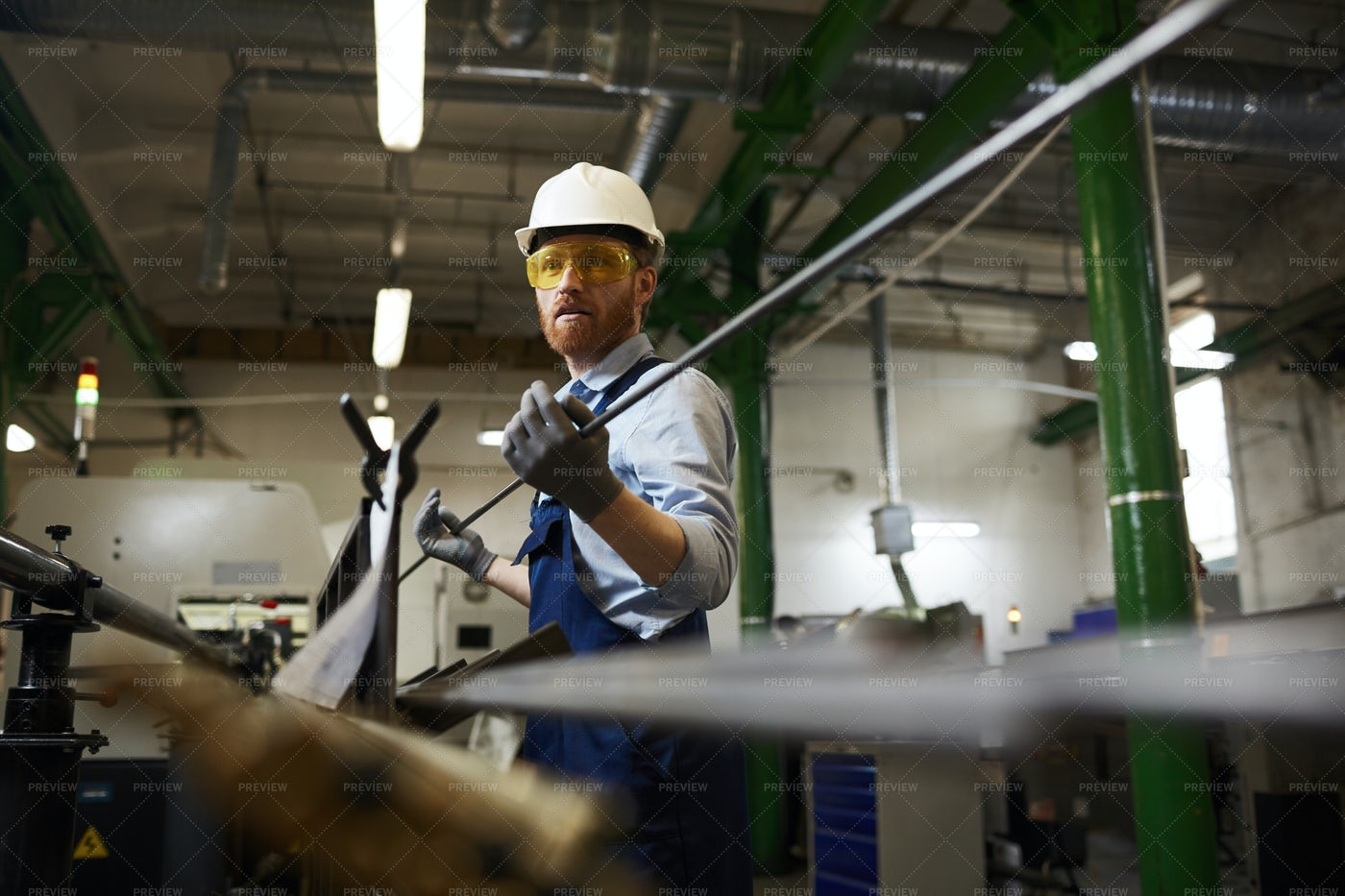Holding An Iron Rod: Stock Photos