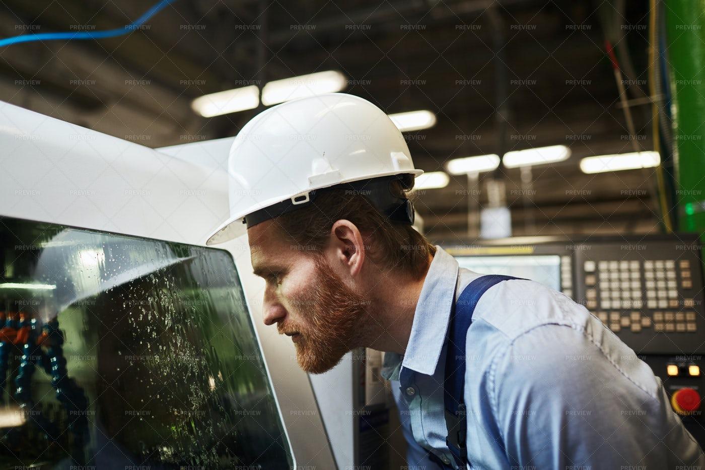 Watching CNC Machine Cleaning: Stock Photos