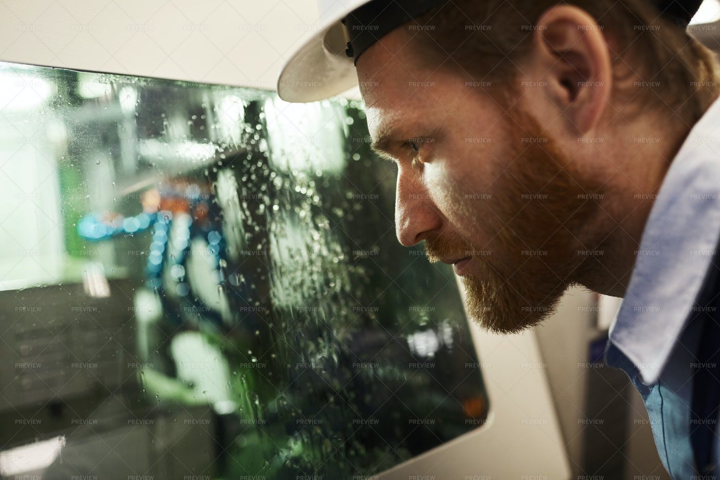 Closely Monitoring CNC Cleaning: Stock Photos