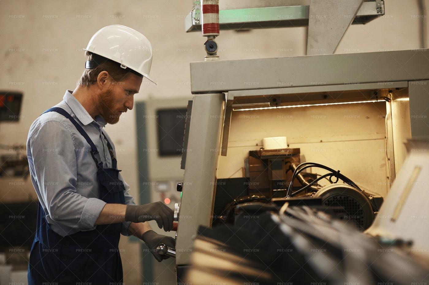 Worker Operating CNC Machine: Stock Photos