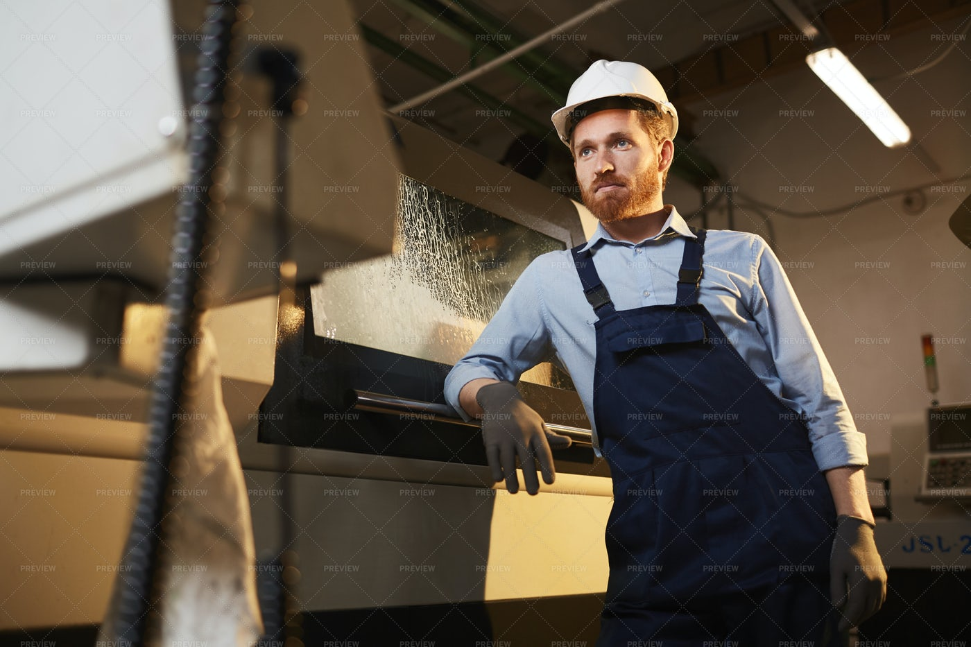 Engineer Standing In The Factory: Stock Photos
