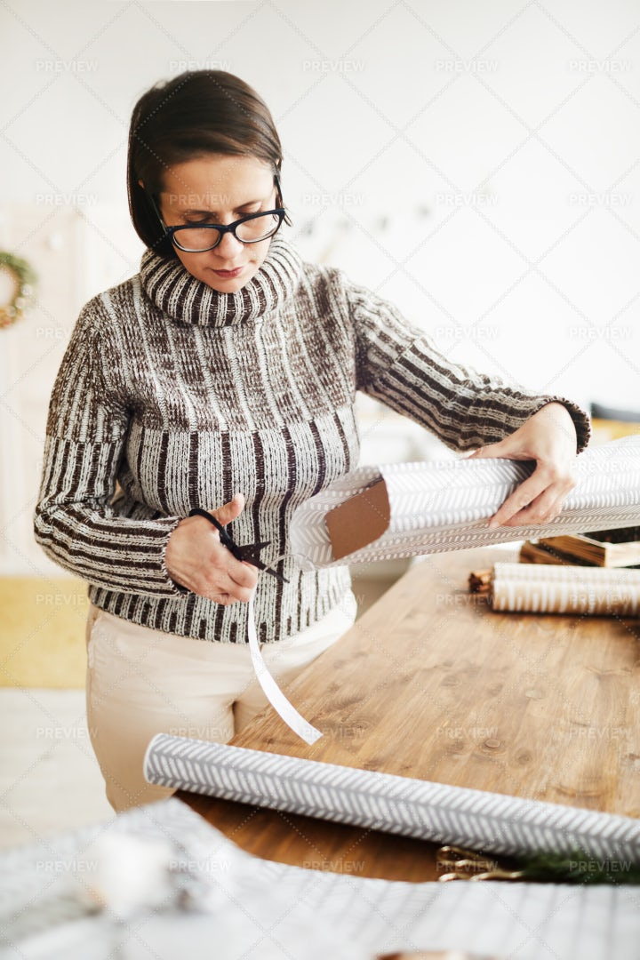 Woman Preparing For Christmas: Stock Photos