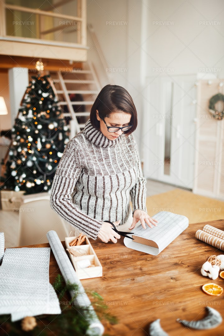 Woman Preparing Gifts: Stock Photos