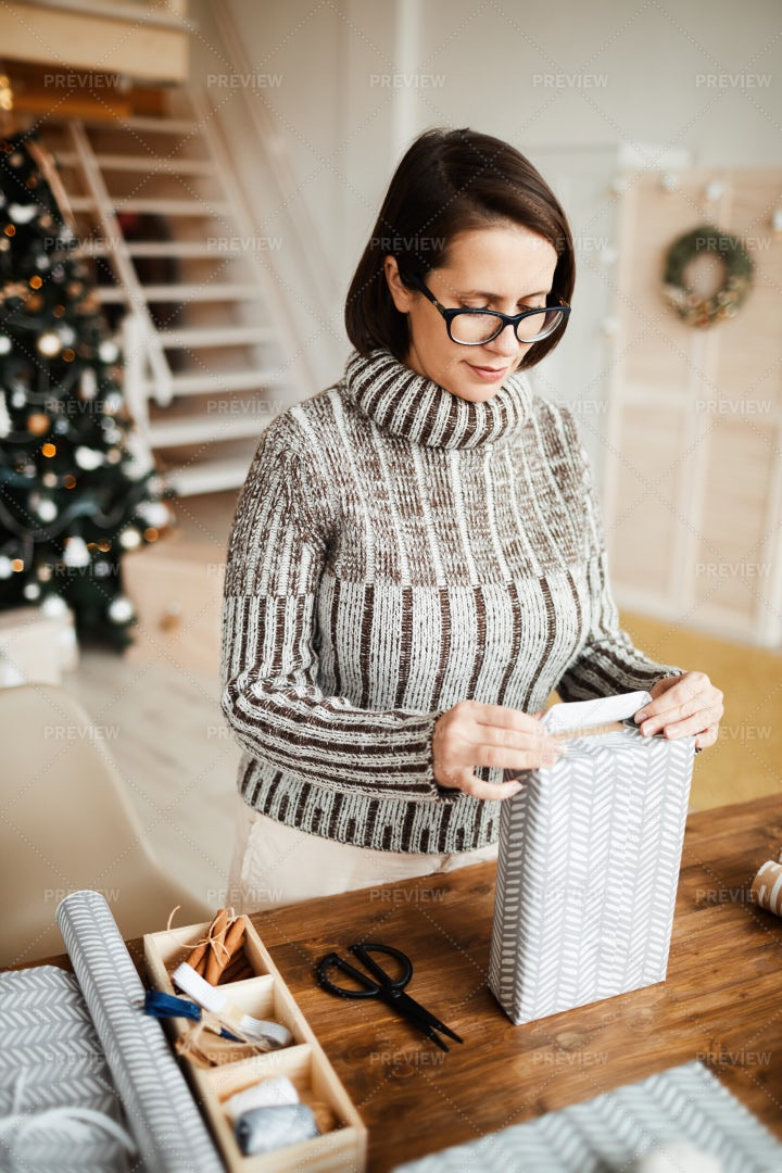 Wrapping Christmas Gifts: Stock Photos