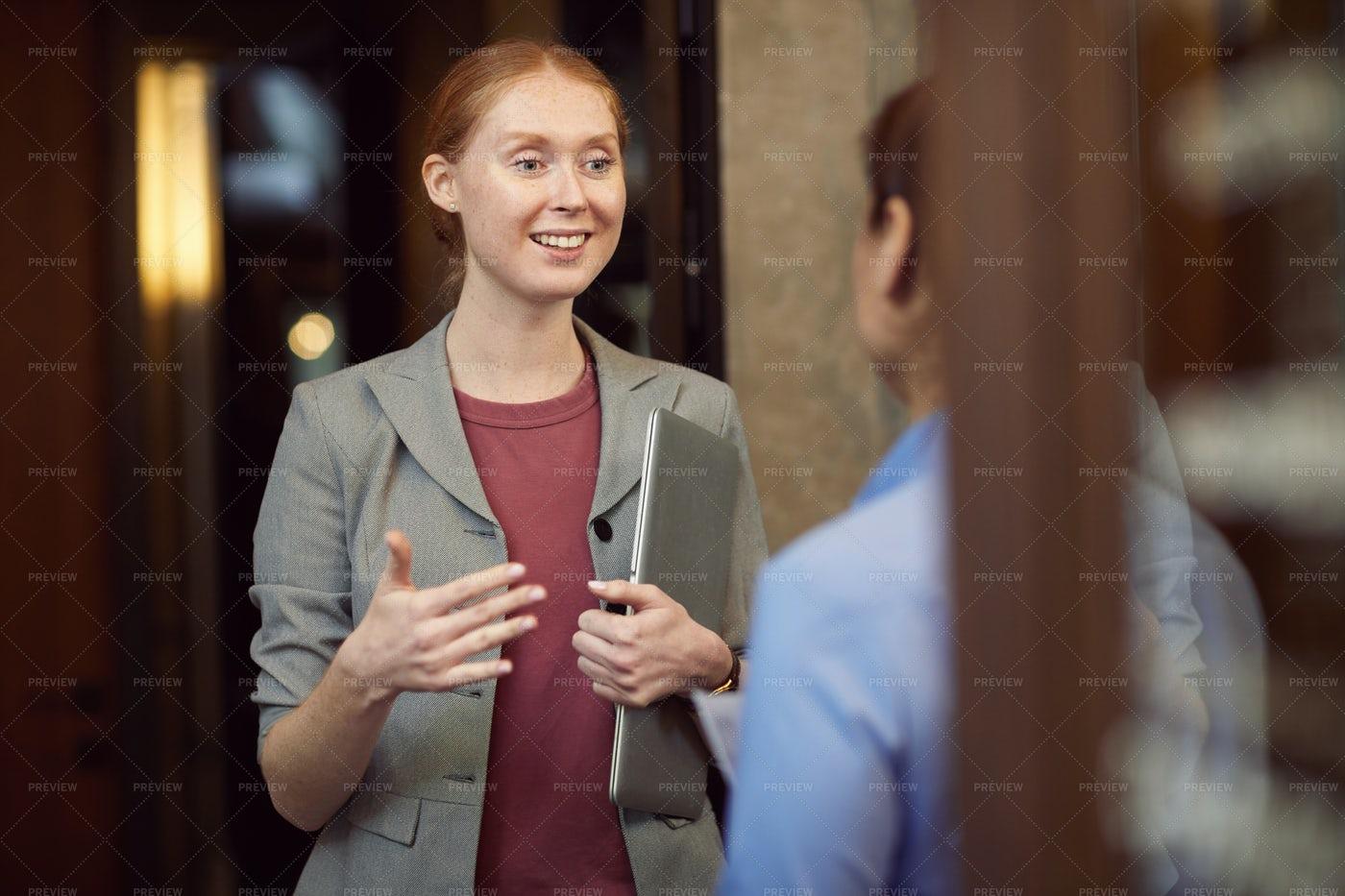 Businesswoman Discussing Work: Stock Photos