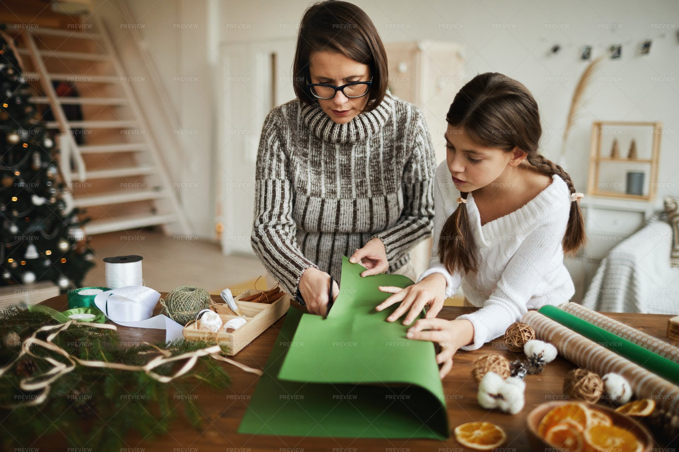 Family Wrapping Presents: Stock Photos
