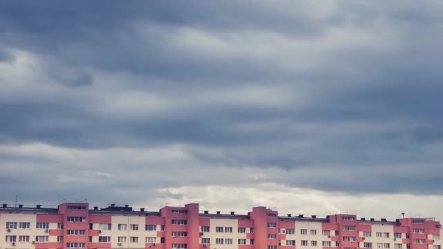 Storm Clouds Over Apartment Building: Stock Video