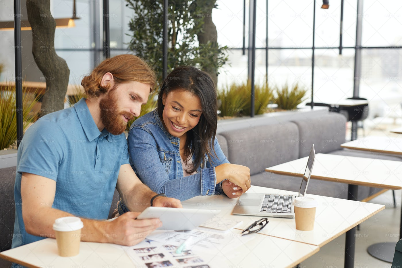 Business Discussion In A Cafe: Stock Photos