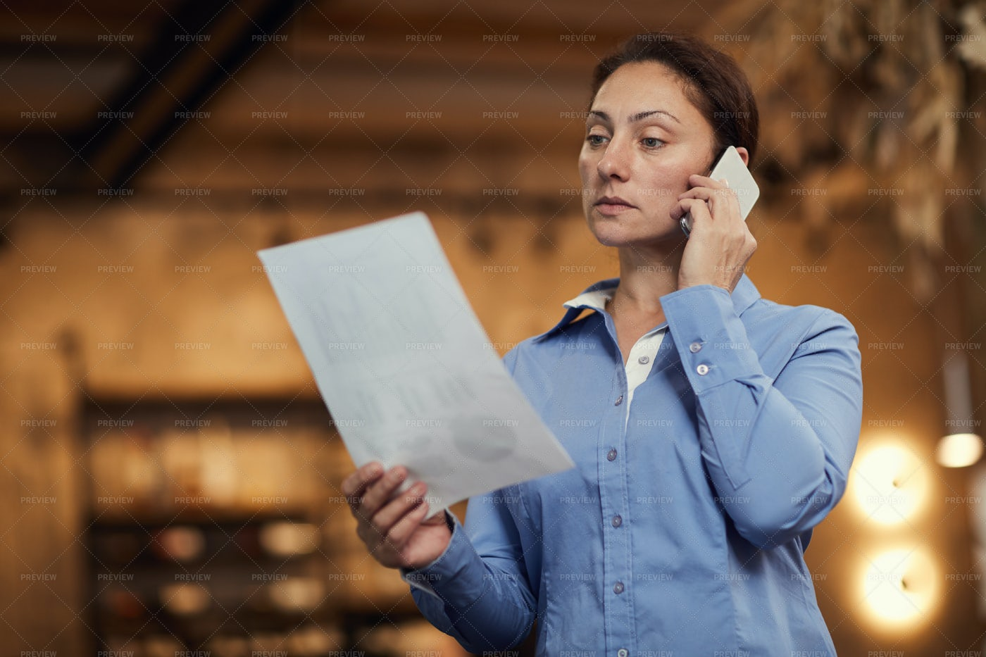 Businesswoman Reading Out Papers: Stock Photos
